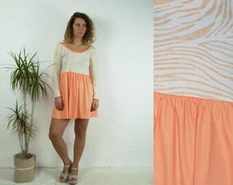 90's vintage women's peach animal printed mini dress
