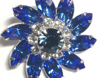 Signed Eisenberg Ice New Vintage Stock Blue and Clear Rhinestones, Sparkly Swirl design. It is 1 1/2 inches round.