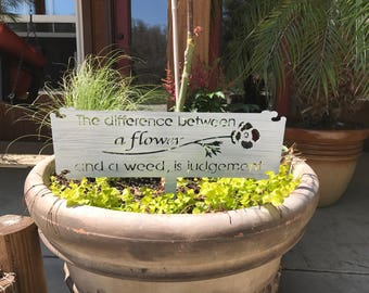 The Difference Between Flowers and Weeds is Judgement metal garden sign