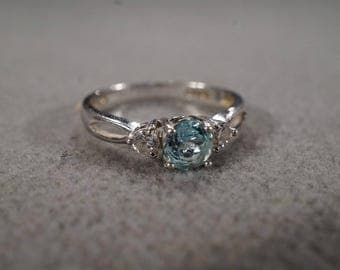 vintage sterling silver statement solitaire multistone ring with large round blue topaz and set with two round white topaz, size 8  M3