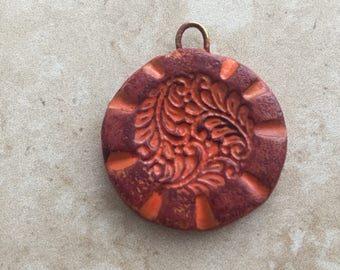 Handmade rustic burgundy and rust leafy floral design faux stoneware polymer clay round focal pendant