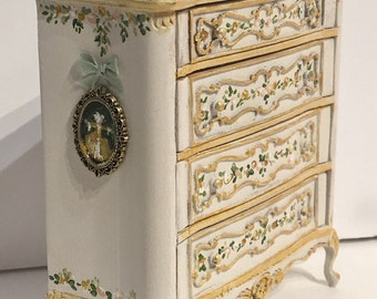 Hand painted drawer in cream tones with marbel top. Scale: 1.12