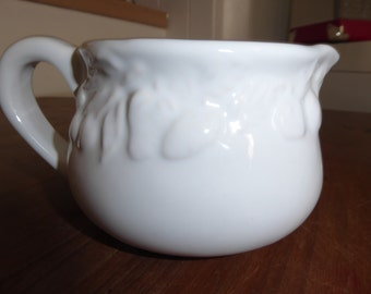 White relief pattern milk/cream jug
