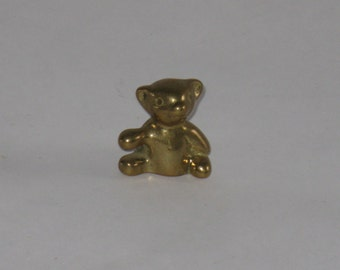 Miniature brass teddy bear figurine