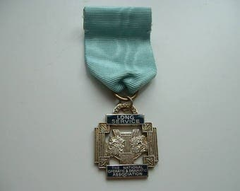 H/M Silver and enamel operatic long service medal