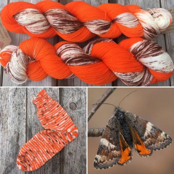 Orange Underwing, 75/25 merino nylon blend speckled indie sock yarn