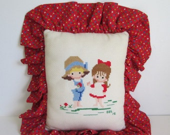 70's Joan Walsh Anglund cross stitch pillow backed in red calico