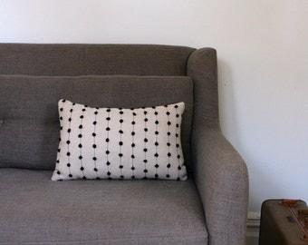 Black pom pillow