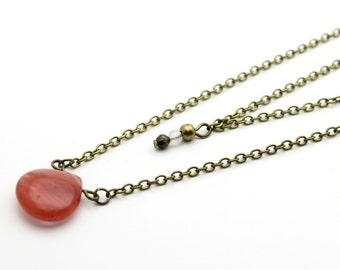 Two bronze ranks and drop cherry quartz necklace