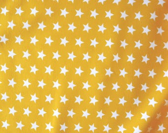 Fabric - Jersey fabric - Gold small star print knit - Cotton/elastane