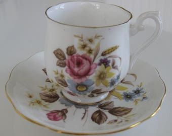 ROYAL ALBERT Bone China Demi-Tasse Cup and Saucer, Pink, Blue, Yellow Flowers. Made in England