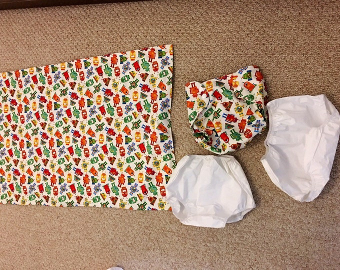 Potty training sets water proof printed fabric under sheet pad and 2 pairs white rubber pants, one pair of printed night time pants
