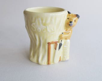 Sooty playing cricket ceramic egg cup - very cute.