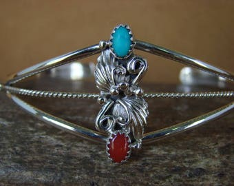 Navajo handmade sterling silver bracelet with turquoise, coral stones, and leaves