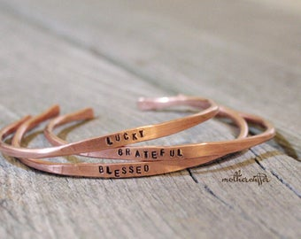 CUSTOM HANDSTAMPED Skinny Copper Bangle by mothercuffer