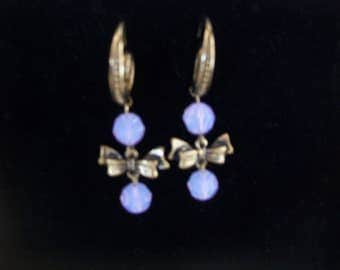 bronze color earring with bow