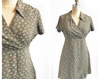 1990's rayon floral print moss green baby doll mini dress. Size S/M.