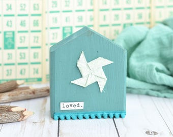Blue House with Pinwheel. Choose Your Word.