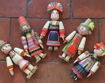 A  Set of Five Wooden Eastern European Dolls in National Dress