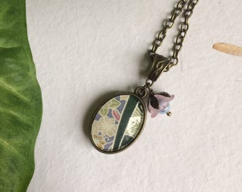 Necklace with pendant made from Japanese paper with glass flower