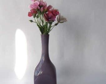 Retro smoky purple cased glass bottle vase with white cased glass inner.