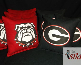 Free Shipping UGA Corn hole Bags Ships in 1-2 Bus.Days Receive Promo Code for 10% off when you Favorite This Shop UGA Cornhole bags
