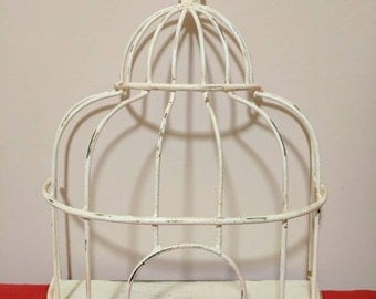 Decorative wire, Bird cage that will set on a table of can be hung on a wall. Free shipping.     Item# 1113161