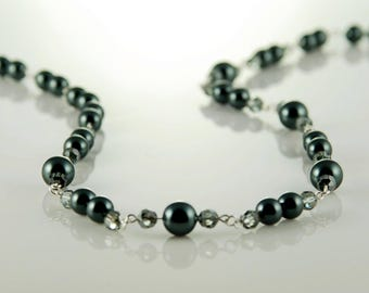 Necklace made with dark blue glass pearls and Swarovski crystals.