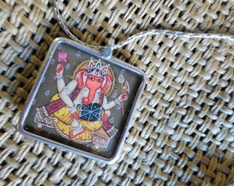 Stunning Ganesha handpainted in sterling silver 925, with carved mandala in other side.