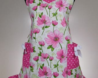 Completely lined  PINK FLORAL apron accented with  pink and white polka dot ruffle and eyelet trim