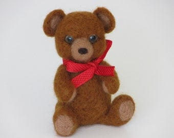 Light brown Teddy Bear with red ribbon