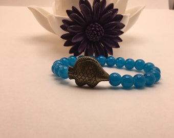Hot Teal Blue beaded flexible bracelet with a Brass Asian Inspired Lucky Fish.