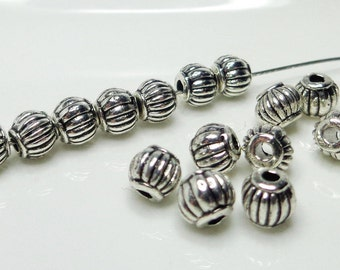 25 spacers, lantern-shaped, 4mm, hole 1mm - Tibetan silver