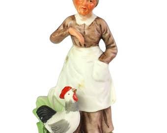 Bisque Porcelain Elderly Old Woman Feeding Rooster Barnyard Grandma Figurine