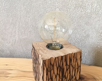 Lamp to ask wooden light bulb filament.