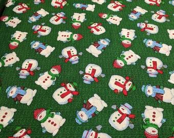 Snowmen on Green Cotton Fabric
