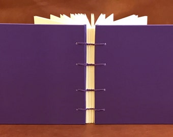 Small journal/photo album handcrafted from repurposed book cover with pansy end papers