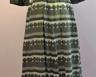 1970's long maxi style dress by California with bell sleeves and a monochrome pattern in Black and White