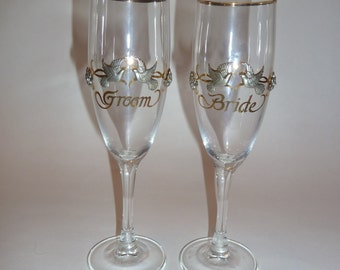 Vintage Bride and Groom Champagne Glasses/Wedding Toasting Flutes/Raised Pewter Doves and floral design/Gold rim and lettering/Gilt