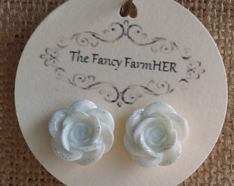 White rose button earrings with glitter accents