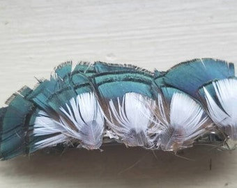 Shimmering green and white feather hair clip