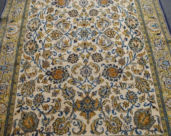 Authentic Persian carpet made hands 210cmx140cm size beige background.