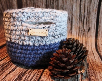 Small soft crocheted basket with crocheted handles, basket deep blue and white gray with handles