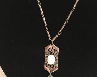 "Vintage artisan handmade silver tone metal linked 22"" necklace with white stone on metal mesh pendant with tassels"