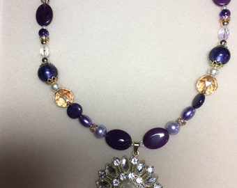 Purple, gold and jeweled necklace