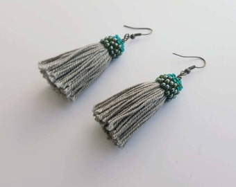 Rustic tassel earrings with green caps and bronze tone hooks