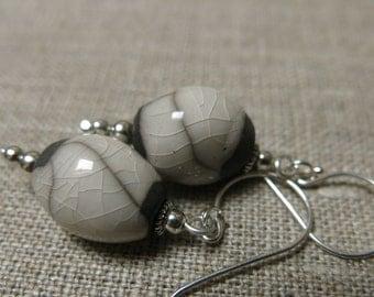 Raku earrings: olive-shaped white beads with Bali silver hooks