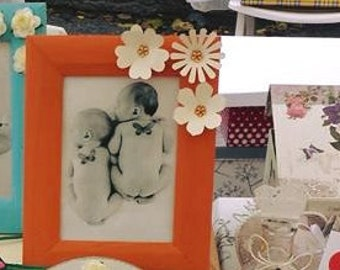 Picture frame-white with orange floral paper inserts