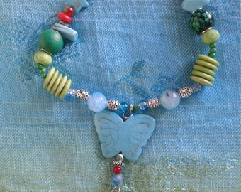 Cupid with a Butterfly Necklace, coral and turquoise