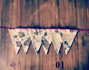 Bunting made from vintage fabric, great for the nursery, balconies, garden parties and all your decor needs!